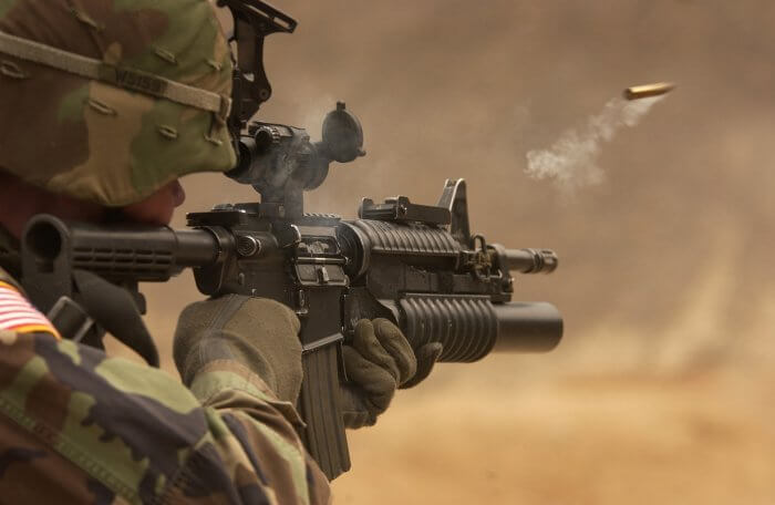 automatic-weapon-bullet-camouflage-close-up