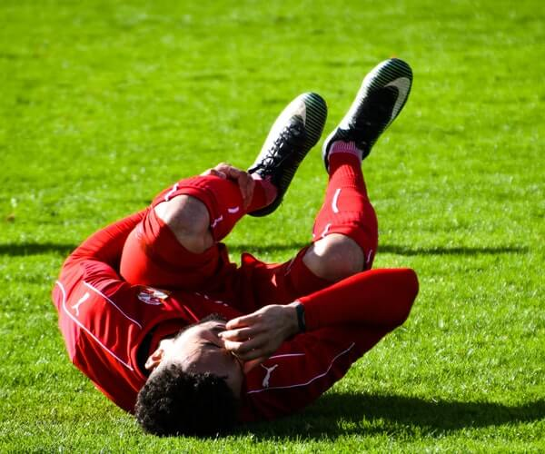adult athlete cramps field