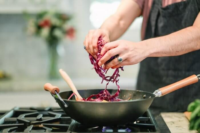 person-cooking-red-cabbage