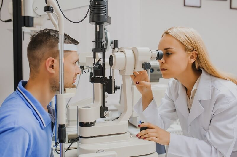 Optometrist checking an Adult eye in the clinic