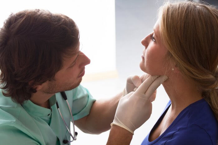 Doctor checking a patient