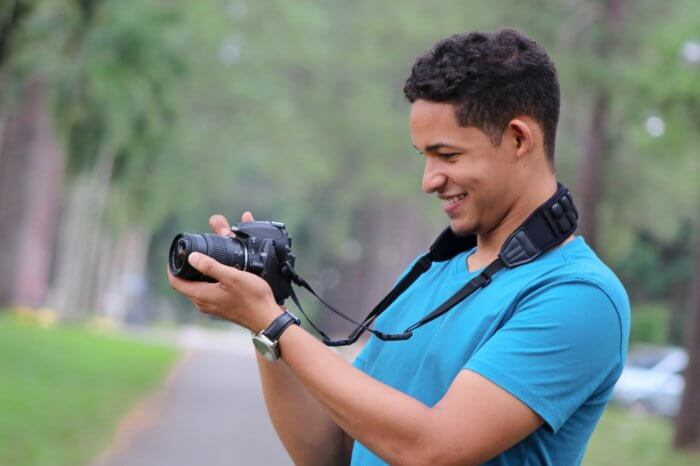 A guy holding Nikon D3400 Camera