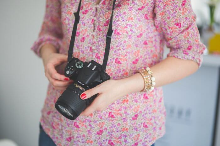 Woman photographer holding Nikon Camera