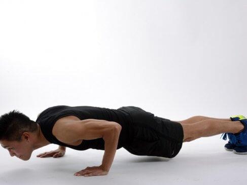Adult doing pushups