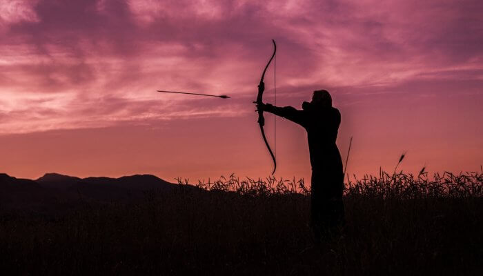 Person holding an arrow for hunting