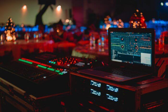 black-laptop-beside-audio-mixer-set