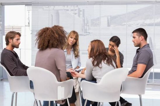Group of people having conversation