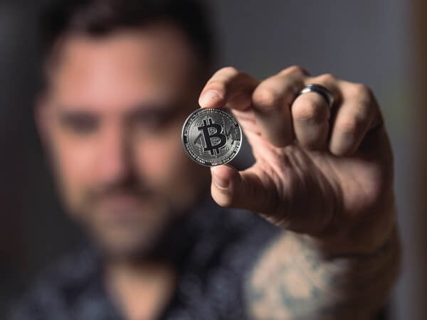 Person holding bitcoin