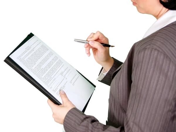 Women wearing shirt holding pen