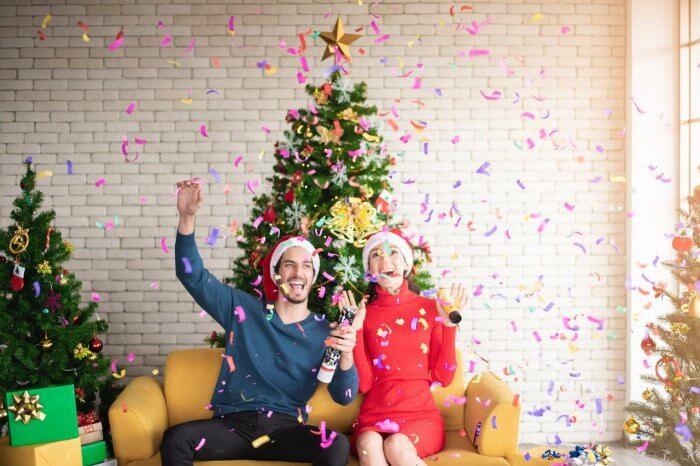 Man and Woman wearing Santa Hats