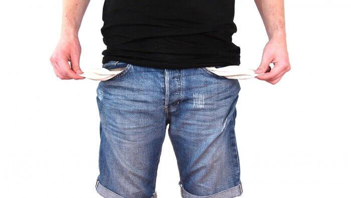 Man shows empty pocket