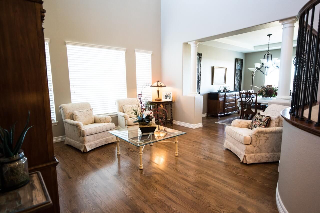 top center table near gray padded armchair